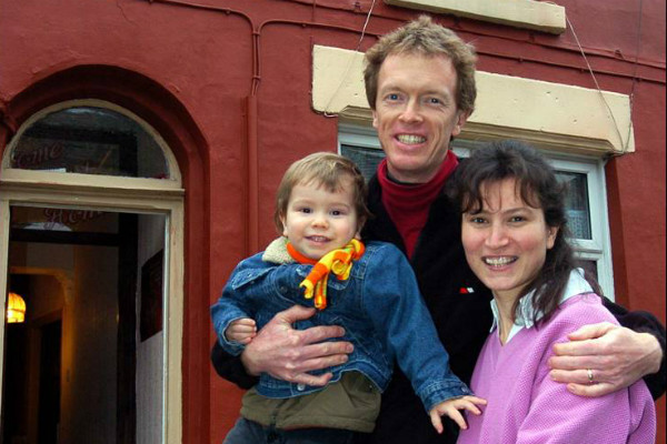 A family on Liverpool's Welsh Streets in 2006, forced out by demolition.