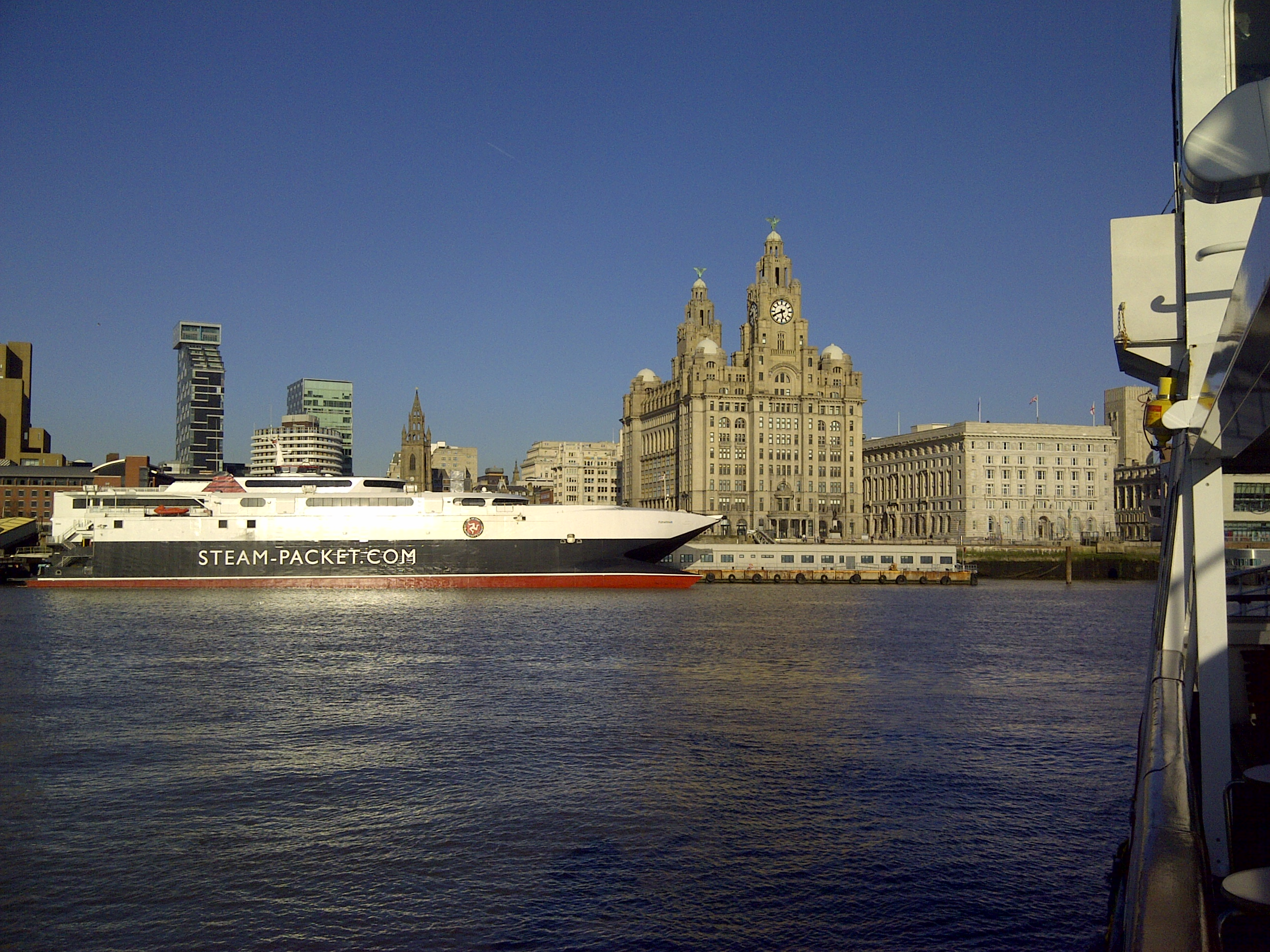 Liverpool's Pier Head with the Isle of Man 'Sea Cat' ferry moored alongside.
