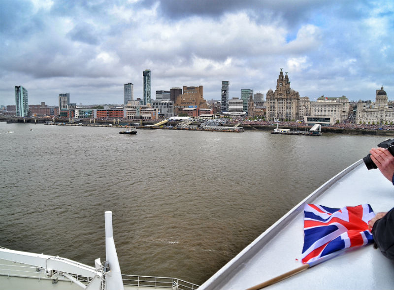 Liverpool's famous Pier Head World Heritage Site skyline under clearing skies from the upper decks of Cunard's Queen Mary 2