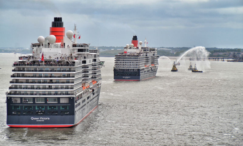 Two of Cunard's Three Queens viewed from on board the third on their 175th anniversary Liverpool tour