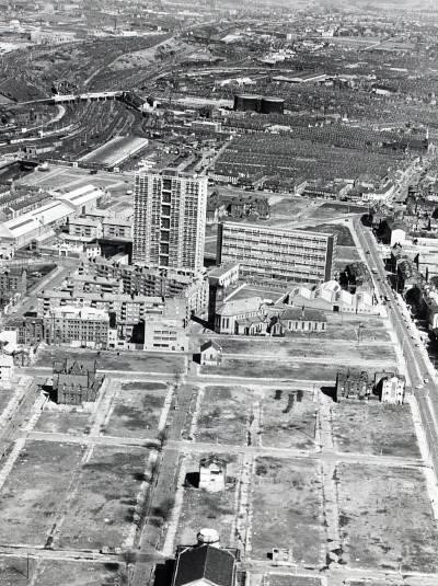The transition between Liverpool 8 and the Edge Hill district in a black and white aerial view from c.1970, showing the extent of housing clearance and the scale of the new high rise and deck access blocks like Entwistle Heights, all of which were demolished within 20 or so years from construction