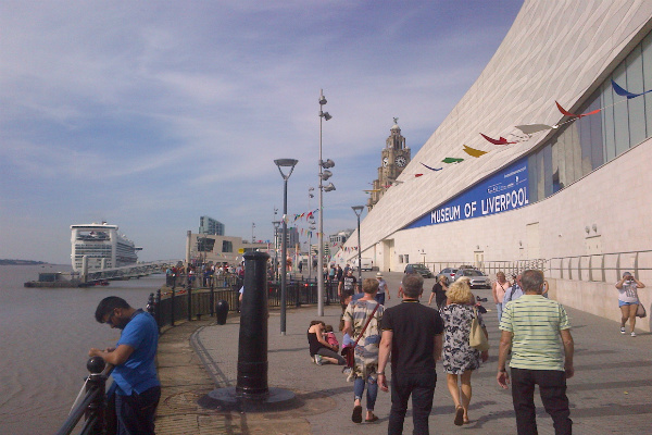 The busy Pier Head on Liverpool's World Heritage Waterfront with Caribbean Princess berthed at the landing stage
