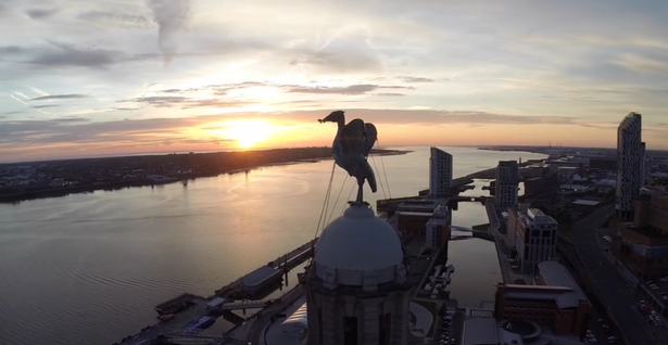 Aerial drone shot across the Mersey with Lyver Bird silhouetted against the sunset.