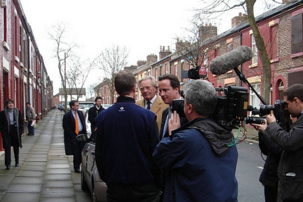 David Cameron and Lord Heseltine visit Madryn St on a tour in March 2006 - their guide - me - stands in the background. Mr Cameron said he was baffled by demolition - but is now funding it.