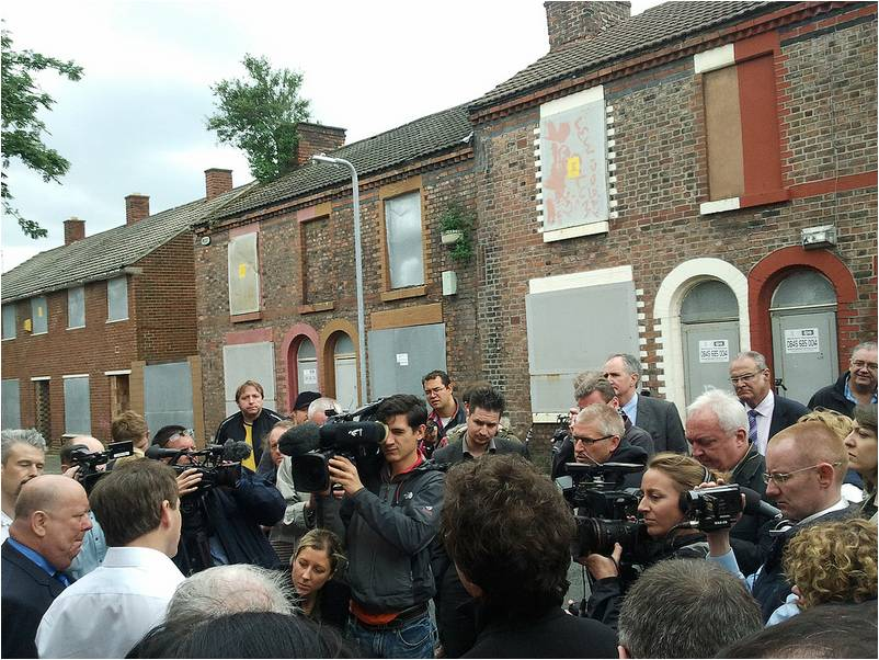 Mayor Anderson and Minister Shapps on Madryn Street in front of the world's press on 15th June 2012, to announce Ringo's house would be saved.